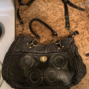 Black and Tan Coach purse